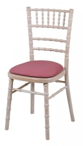 Limewashed Camelot Limewashed camelot chair with pink seat pad